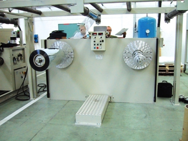 Automatic winder for plastic films